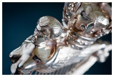 Detail of a silver Royal Irish Regiment cap badge sculpture