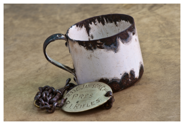 A miniature tin cup for measuring a tot of rum