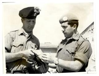 Exchanging caubeen for blue beret United Nations